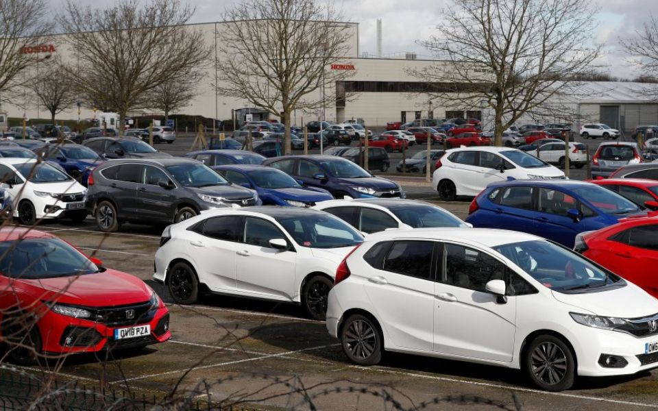 Online car dealer firm Auto Trader announces board shakeup with retirement of CEO