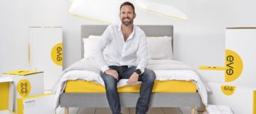 Eve Sleep CEO James Sturrock sits on one of his company's mattresses