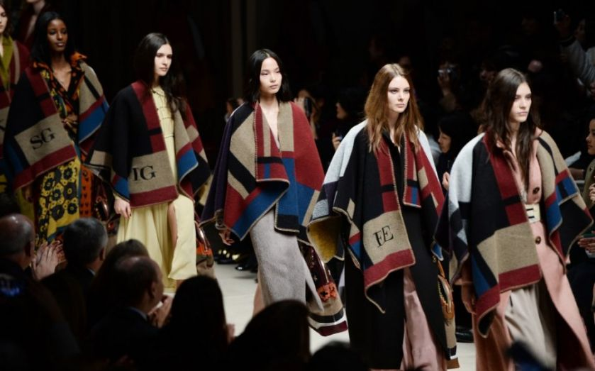 First quarter sales lift at Burberry despite drag from Asian markets as chief executive Christopher Bailey braces for more shareholder dissent