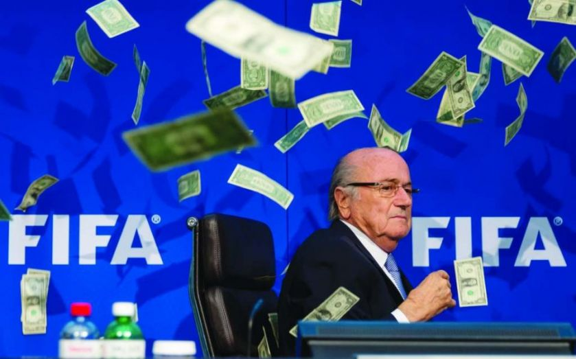"Fifa's Sepp Blatter showered with fake money in prank by comedian Simon Brodkin: ""This is for North Korea in 2026"""