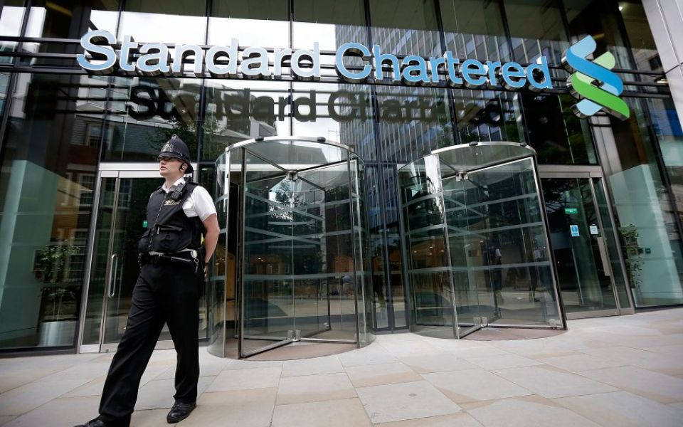 Standard Chartered looks to win over investors with $1bn share buyback