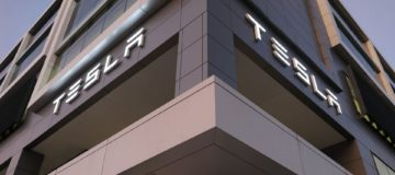 Tesla tops revenue forecasts but profits take a hit