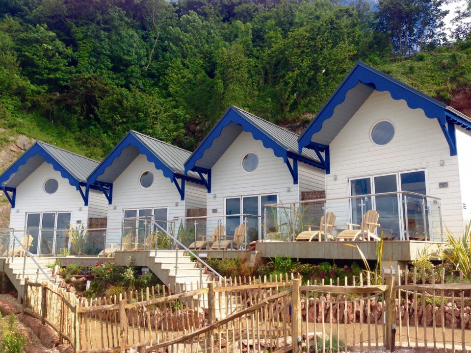 The beach huts at the Cary Arms & Spa