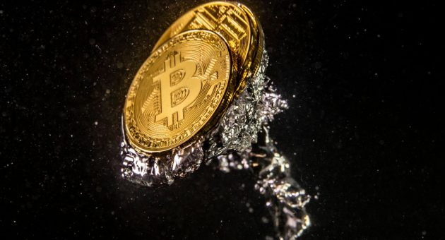 LONDON, ENGLAND - AUGUST 15: (EDITORS NOTE: Image has been rotated 180 degrees.) In this photo illustration a visual representation of the digital currency Bitcoin sinks into water on August 15, 2018 in London, England. Most digital currencies including Bitcoin, (BTC) Ethereum, (ETH) Ripple (XRP) and Stella (XLM) have seen a dramatic fall in their prices throughout 2018 amid a 'mass sell-off'. In December 2017 the price of BTC hit $20,000 USD but has since fallen to around $6000 USD. (Photo Illustration by Dan Kitwood/Getty Images)