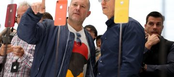 CUPERTINO, CA - SEPTEMBER 12: Apple chief design officer Jony Ive (L) and Apple CEO Tim Cook inspect the new iPhone XR during an Apple special event at the Steve Jobs Theatre on September 12, 2018 in Cupertino, California. Apple released three new versions of the iPhone and an update Apple Watch. (Photo by Justin Sullivan/Getty Images)