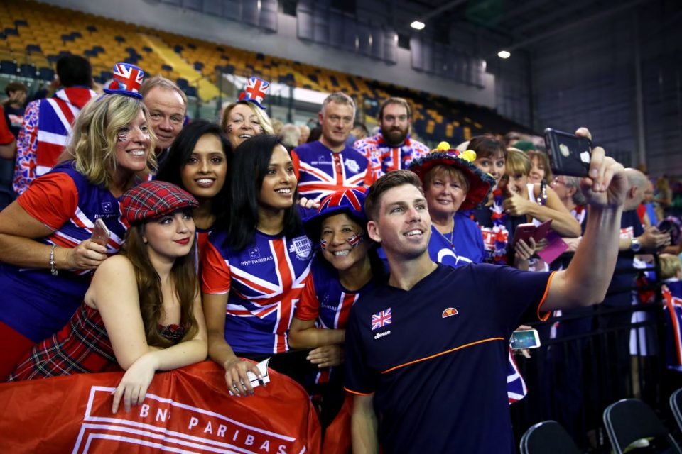 GLASGOW, SCOTLAND - SEPTEMBER 16:  Cameron Norrie of Great Britain celebrates with fans after winning his match against Sanjar Fayziev of Uzbekistan during day three of the Davis Cup by BNP Paribas World Group Play off between Great Britain and Uzbekistan at Emirates Arena on September 16, 2018 in Glasgow, Scotland.  (Photo by Clive Brunskill/Getty Images)