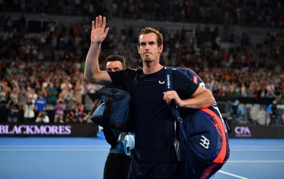TOPSHOT - Britain's Andy Murray waves to supporters after his defeat against Spain's Roberto Bautista Agut during their men's singles match on day one of the Australian Open tennis tournament in Melbourne on January 14, 2019. (Photo by SAEED KHAN / AFP) / -- IMAGE RESTRICTED TO EDITORIAL USE - STRICTLY NO COMMERCIAL USE --        (Photo credit should read SAEED KHAN/AFP/Getty Images)