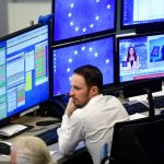 A trader at the Frankfurt Stock Exchange in Germany weighs up the state of the Eurozone economy