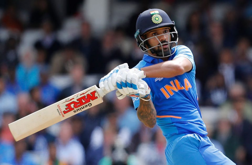 India's Shikhar Dhawan plays a shot during the 2019 Cricket World Cup group stage match between India and Australia at The Oval in London on June 9, 2019. (Photo by Adrian DENNIS / AFP) / RESTRICTED TO EDITORIAL USE        (Photo credit should read ADRIAN DENNIS/AFP/Getty Images)