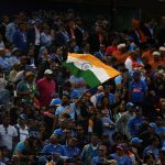 India's supporters wave a national flag during the 2019 Cricket World Cup group stage match between India and Australia at The Oval in London on June 9, 2019. (Photo by Dibyangshu SARKAR / AFP) / RESTRICTED TO EDITORIAL USE (Photo credit should read DIBYANGSHU SARKAR/AFP/Getty Images)