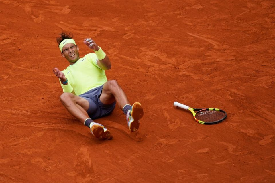 TOPSHOT - Spain's Rafael Nadal celebrates after winning against Austria's Dominic Thiem during their men's singles final match, on day fifteen of The Roland Garros 2019 French Open tennis tournament in Paris on June 9, 2019. (Photo by Kenzo TRIBOUILLARD / AFP)        (Photo credit should read KENZO TRIBOUILLARD/AFP/Getty Images)