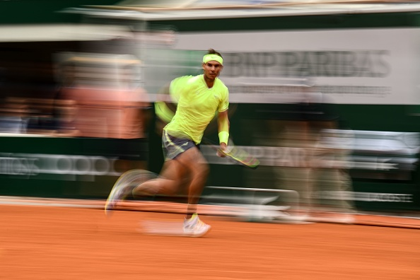 TOPSHOT - Spain's Rafael Nadal returns the ball to Austria's Dominic Thiem during their men's singles final match, on day fifteen of The Roland Garros 2019 French Open tennis tournament in Paris on June 9, 2019. (Photo by Martin BUREAU / AFP)        (Photo credit should read MARTIN BUREAU/AFP/Getty Images)