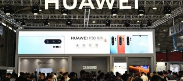 People gather at a Huawei stand during the Consumer Electronics Show, Ces Asia 2019 in Shanghai on June 11, 2019. (Photo by HECTOR RETAMAL / AFP) (Photo credit should read HECTOR RETAMAL/AFP/Getty Images)