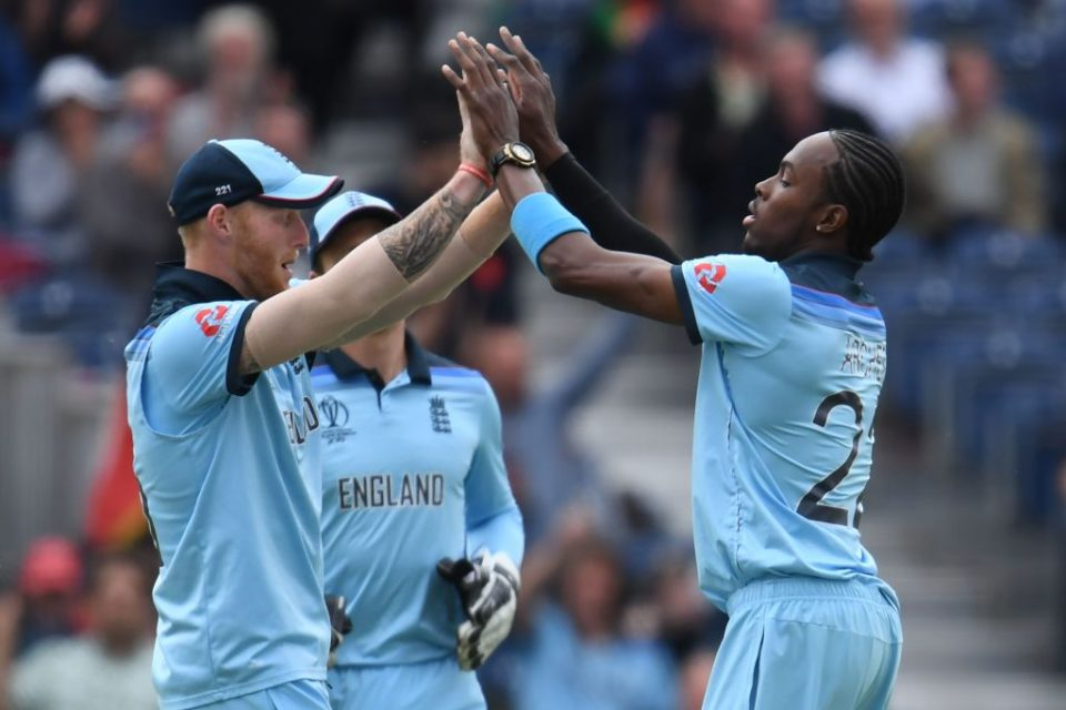 England's Jofra Archer (R) celebrates taking the wicket of Afghanistan's Rashid Khan during the 2019 Cricket World Cup group stage match between England and Afghanistan at Old Trafford in Manchester, northwest England, on June 18, 2019. (Photo by Dibyangshu SARKAR / AFP) / RESTRICTED TO EDITORIAL USE        (Photo credit should read DIBYANGSHU SARKAR/AFP/Getty Images)