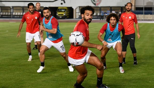 Egypt's forward Mohamed Salah (C) Egypt's defender Abdullah al-Saeed (2nd-L) and Egypt's midfielder Amr Warda (2nd-R) vie for the ball during a training session two days ahead of their opening match against Zimbabwe in the 2019 football Africa Cup of Nations (CAN) on June 19, 2019 at the Cairo Military Academy Stadium in the Egyptian capital. (Photo by Khaled DESOUKI / AFP) (Photo credit should read KHALED DESOUKI/AFP/Getty Images)