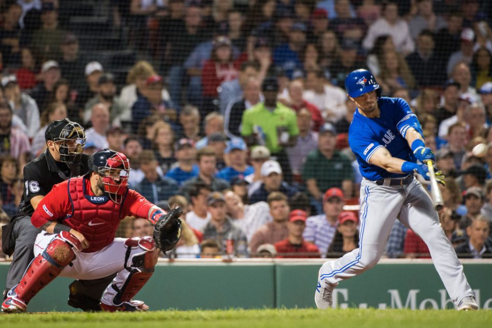 BOSTON, MA - JUNE 21: Randal Grichuk #15 of the Toronto Blue Jays hits a RBI single in the seventh inning against the Boston Red Sox at Fenway Park on June 21, 2019 in Boston, Massachusetts. (Photo by Kathryn Riley /Getty Images)