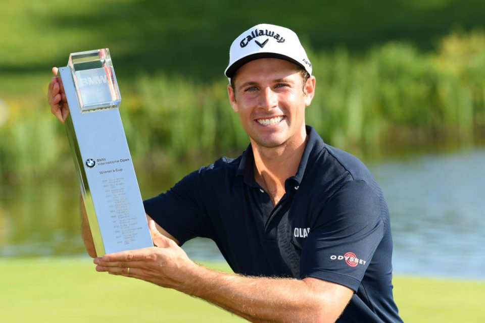 MUNICH, GERMANY - JUNE 23:   Andrea Pavan of Italy poses with the trophy after his victory during a playoff during day four of the BMW International Open at Golfclub Munchen Eichenried on June 23, 2019 in Munich, Germany. (Photo by Stuart Franklin/Getty Images)