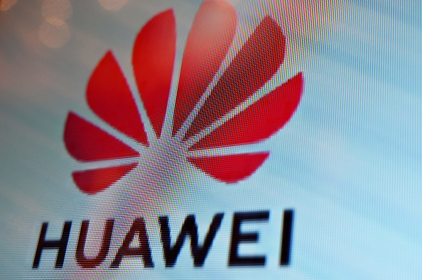 A Huawei logo is seen on a screen during the Mobile World Congress (MWC 2019) introducing next-generation technology at the Shanghai New International Expo Centre (SNIEC) in Shanghai on June 26, 2019. (Photo by Hector RETAMAL / AFP) (Photo credit should read HECTOR RETAMAL/AFP/Getty Images)