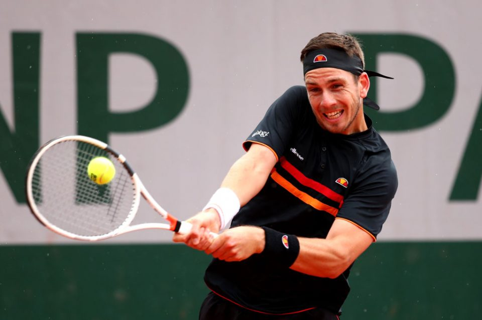 PARIS, FRANCE - MAY 28: Cameron Norrie of Great Britain plays a backhand during his mens singles first round match against Elliot Benchetrit of France during Day three of the 2019 French Open at Roland Garros on May 28, 2019 in Paris, France. (Photo by Clive Brunskill/Getty Images)