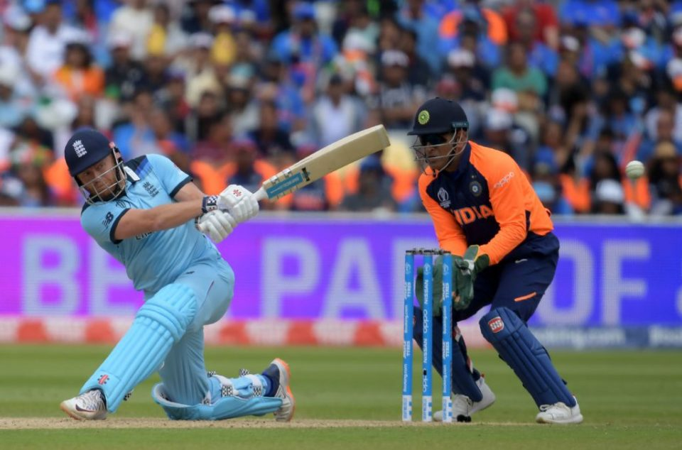 England's Jonny Bairstow (L) is watched by India's Mahendra Singh Dhoni as he plays a shot during the 2019 Cricket World Cup group stage match between England and India at Edgbaston in Birmingham, central England, on June 30, 2019. (Photo by Dibyangshu Sarkar / AFP) / RESTRICTED TO EDITORIAL USE        (Photo credit should read DIBYANGSHU SARKAR/AFP/Getty Images)