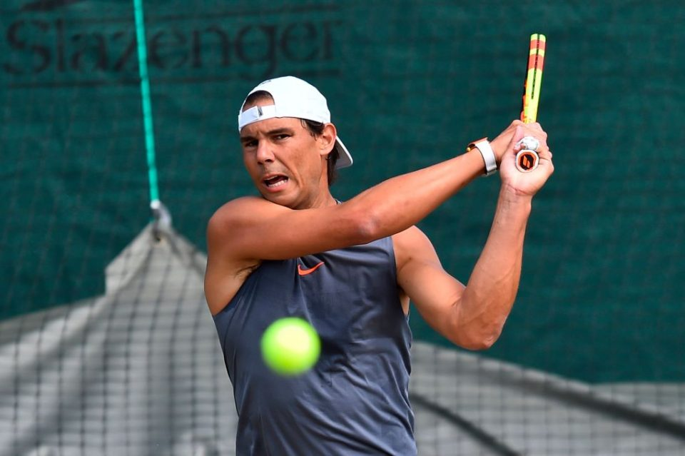 Rafael Nadal hits a return during a practice session at The All England Tennis Club in Wimbledon, southwest London, on June 30, 2019, on the eve of the start of the 2019 Wimbledon Championships tennis tournament. (Photo by Glyn KIRK / AFP) / RESTRICTED TO EDITORIAL USE        (Photo credit should read GLYN KIRK/AFP/Getty Images)