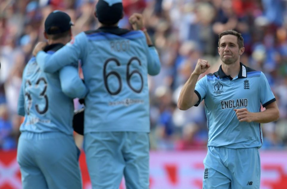 England's Chris Woakes (R) celebrates after the dismissal of India's Rohit Sharma during the 2019 Cricket World Cup group stage match between England and India at Edgbaston in Birmingham, central England, on June 30, 2019. (Photo by Dibyangshu Sarkar / AFP) / RESTRICTED TO EDITORIAL USE        (Photo credit should read DIBYANGSHU SARKAR/AFP/Getty Images)