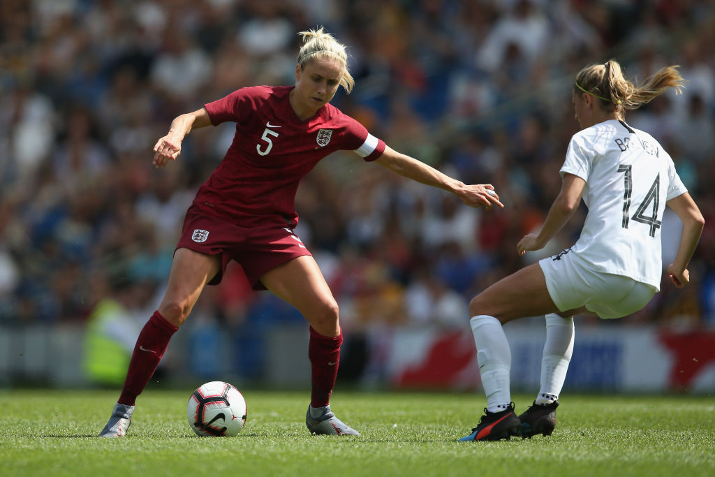BRIGHTON, ENGLAND - JUNE 01: Steph Houghton of England Women takes on Katie Bowen of New Zealand Women battle for the ball during the International Friendly between England Women and New Zealand Women at Amex Stadium on June 01, 2019 in Brighton, England. (Photo by Steve Bardens/Getty Images)