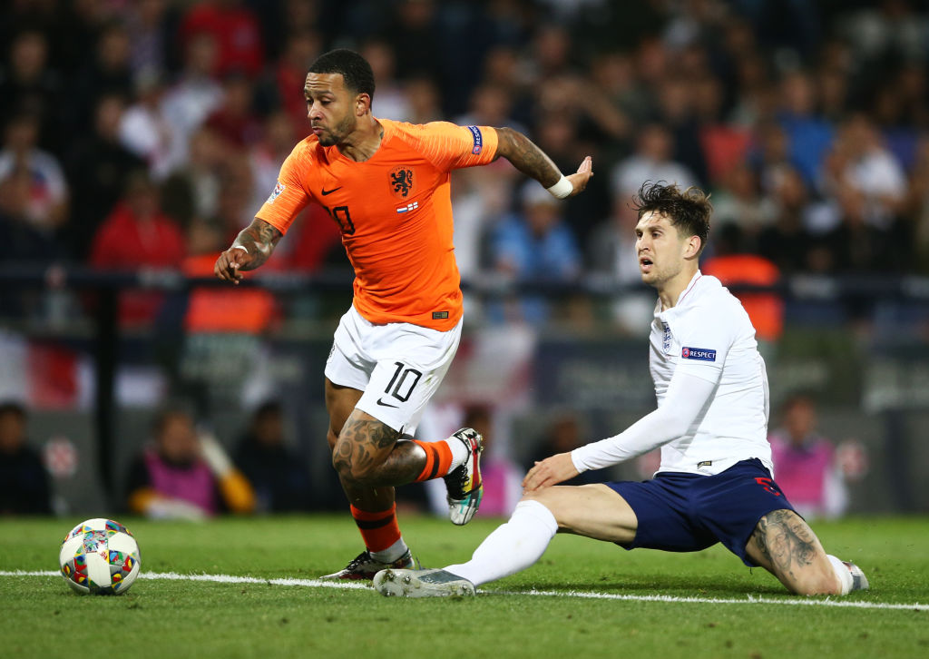 GUIMARAES, PORTUGAL - JUNE 06: Memphis Depay of the Netherlands evades John Stones of England during the UEFA Nations League Semi-Final match between the Netherlands and England at Estadio D. Afonso Henriques on June 06, 2019 in Guimaraes, Portugal. (Photo by Jan Kruger/Getty Images)