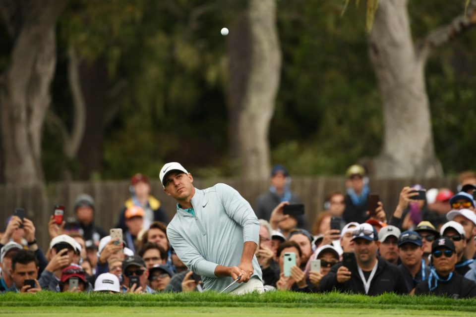 PEBBLE BEACH, CALIFORNIA - JUNE 16: Brooks Koepka of the United States plays a third shot on the 14th hole during the final round of the 2019 U.S. Open at Pebble Beach Golf Links on June 16, 2019 in Pebble Beach, California. (Photo by Ross Kinnaird/Getty Images)