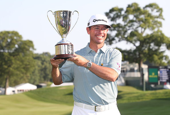 CROMWELL, CONNECTICUT - JUNE 23: Chez Reavie of the United States poses with the trophy after winning the Travelers Championship at TPC River Highlands on June 23, 2019 in Cromwell, Connecticut. (Photo by Rob Carr/Getty Images)