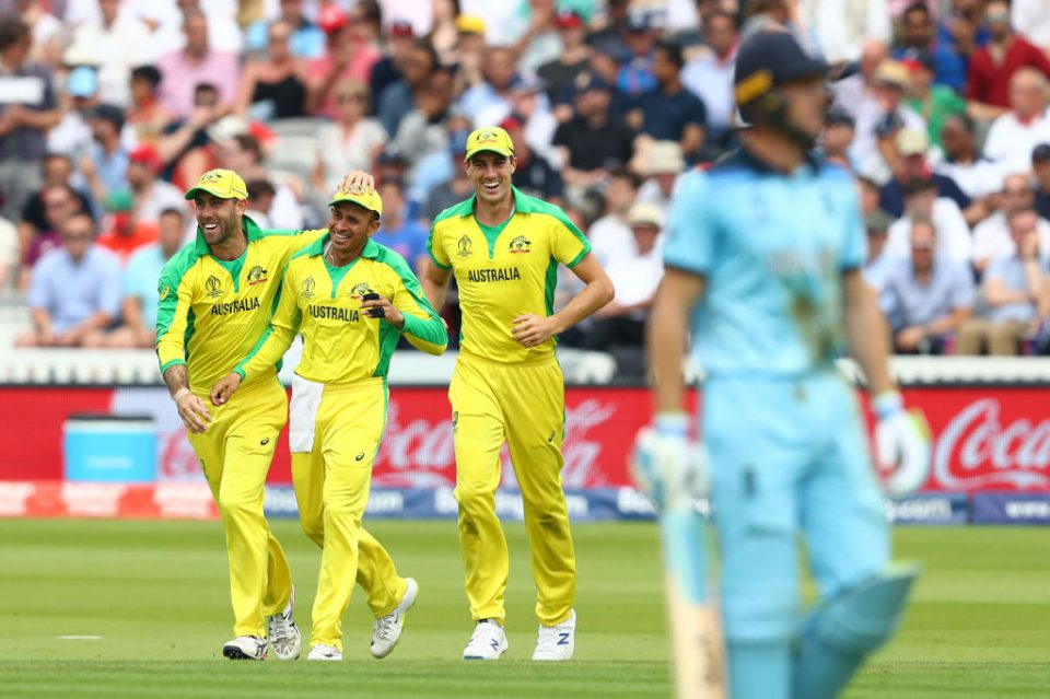 LONDON, ENGLAND - JUNE 25: Usman Khawaja (2l) of Australia celebrates with Glenn Maxwell (l), and Pat Cummins (r) after taking a catch to dismiss Jos Buttler of England off the bowling of Marcus Stoinis during the Group Stage match of the ICC Cricket World Cup 2019 between England and Australia at Lords on June 25, 2019 in London, England. (Photo by Michael Steele/Getty Images)
