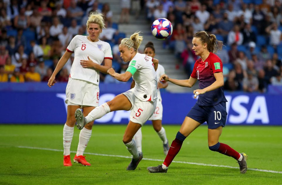 LE HAVRE, FRANCE - JUNE 27:  Steph Houghton of England clears the ball under pressure from Caroline Graham Hansen of Norway during the 2019 FIFA Women's World Cup France Quarter Final match between Norway and England at Stade Oceane on June 27, 2019 in Le Havre, France. (Photo by Richard Heathcote/Getty Images)