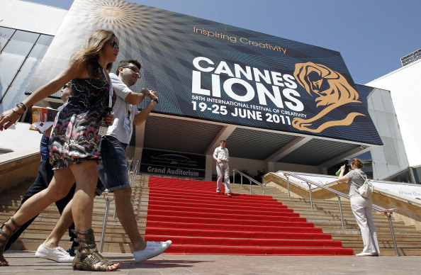People walk on June 21, 2011 in front of the Palais des Festivals where take place the 58th edition of the International festival of creativity, Cannes Lions on June 21 2011, in Cannes on French riviera. AFP PHOTO / SEBASTIEN NOGIER (Photo credit should read SEBASTIEN NOGIER/AFP/Getty Images)