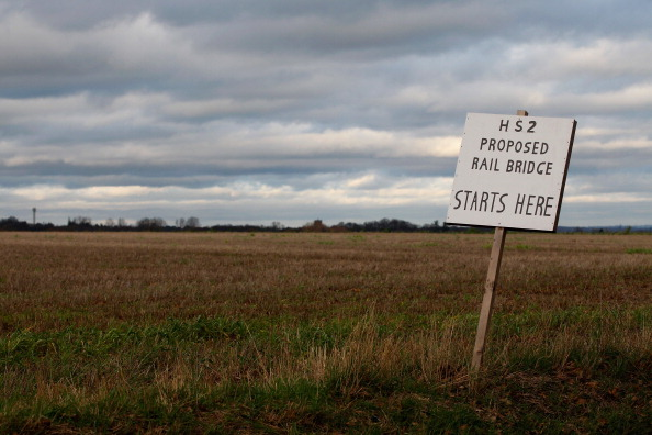 MIDDLETON, UNITED KINGDOM - JANUARY 10: A placard erected by protesters marks the spot where a new rail bridge is proposed to be built across the countryside for the new HS2 high speed train link at the village of Middleton in Staffordshire on January 10, 2012 in Middleton, United Kingdom. The government today gave the go ahead for the proposed high-speed rail line between London and Birmingham which will be routed through countryside with trains travelling as fast as 225 mph. (Photo by Christopher Furlong/Getty Images)