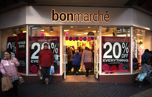 ROTHERHAM, UNITED KINGDOM - DECEMBER 04: Clothing shop bonmarche entice customers with 20% discounts on December 4, 2012 in Rotherham, United Kingdom. Retailers across Britain are struggling as people wait for bigger discounts before spending for the Christmas period. The British Retail Consortium (BRC) said that it's members were in a 'state of nervousness' in the last weeks of the festive period. (Photo by Christopher Furlong/Getty Images)