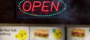 BRISTOL, ENGLAND - JANUARY 07: An open sign outside a branch of a takeaway chain on January 7, 2013 in Bristol, England. A government-backed TV advert - made by Aardman, the creators of Wallace and Gromit - to promote healthy eating in England, is to be shown for the first time later today. England has one of the highest rates of obesity in Europe - costing the NHS 5 billion GDP each year - with currently over 60 percent of adults and a third of 10 and 11 year olds thought to be overweight or obese. (Photo by Matt Cardy/Getty Images)