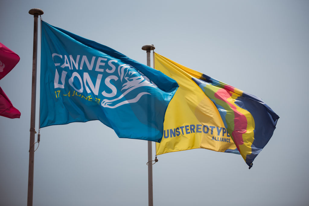 CANNES, FRANCE - JUNE 21: The Cannes Lions flag flies next to the Unstereotype Alliance flag over the Palais of the Cannes Lions International Festival of Creativity highlighting their respective commitments to advancing progressive portrayals of gender in advertising on June 21, 2017 in Cannes, France. (Photo by Francois Durand/Getty Images for Unilever)