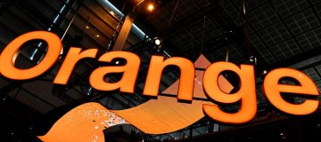 A logo of the French multinational telecommunications corporation, Orange, is displayed in luminous letters, during the Vivatec trade fair (Viva Technology), on May 24, 2018, in Paris. (Photo by ALAIN JOCARD / AFP) (Photo credit should read ALAIN JOCARD/AFP/Getty Images)