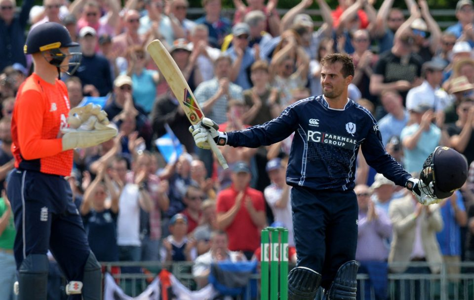 EDINBURGH, SCOTLAND - JUNE 10: Callum MacLeod of Scotland celebrates reaching 100 runs during the One Day International match between Scotland and England at The Grange on June 10, 2018 in Edinburgh, Scotland. (Photo by Mark Runnacles/Getty Images)