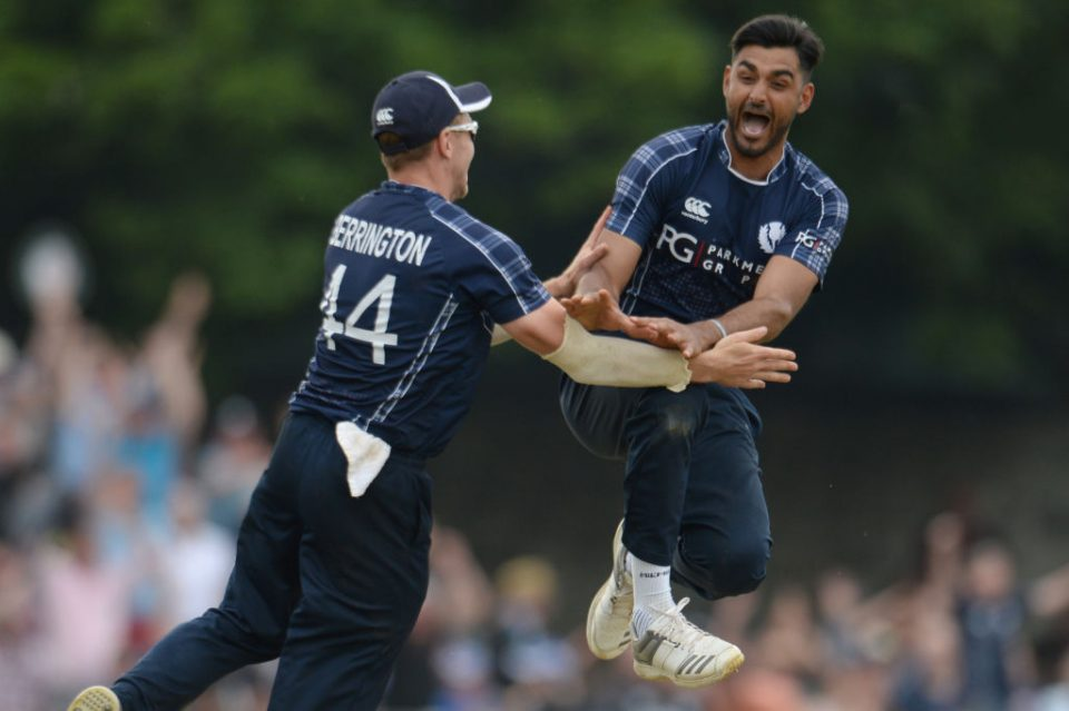 EDINBURGH, SCOTLAND - JUNE 10: Safyaan Sharif celebrates after taking the final wicket of Mark Wood as Scotland won the One-Day International match  between Scotland and England at Grange cricket club ground on June 10, 2018 in Edinburgh, Scotland. (Photo by Philip Brown/Getty Images)