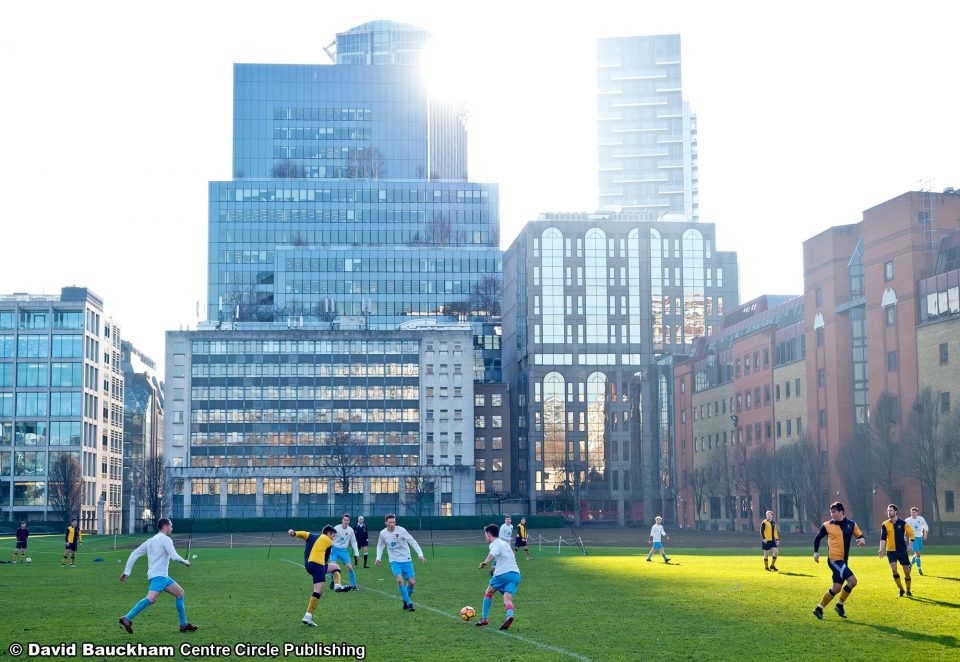 The Honourable Artillery Company Football Club plays against a backdrop of the City of London's distinctive skyline.