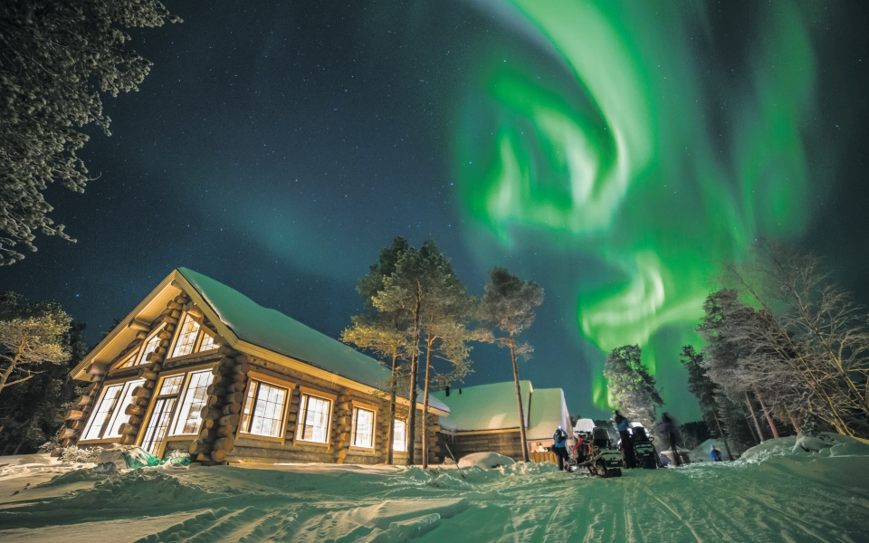 Trek across the ice fields of Finland on a Northern Lights tour