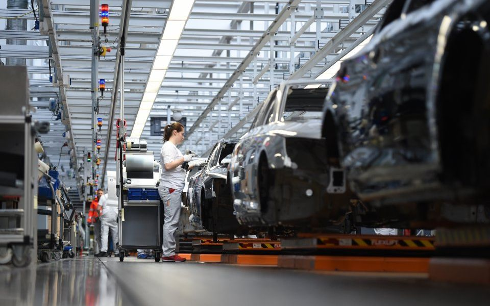 German manufacturing output falls but services push economy to growth