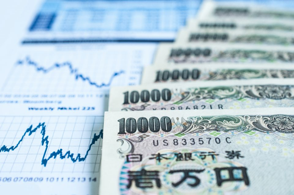Japanese stocks surf higher over troubled waters