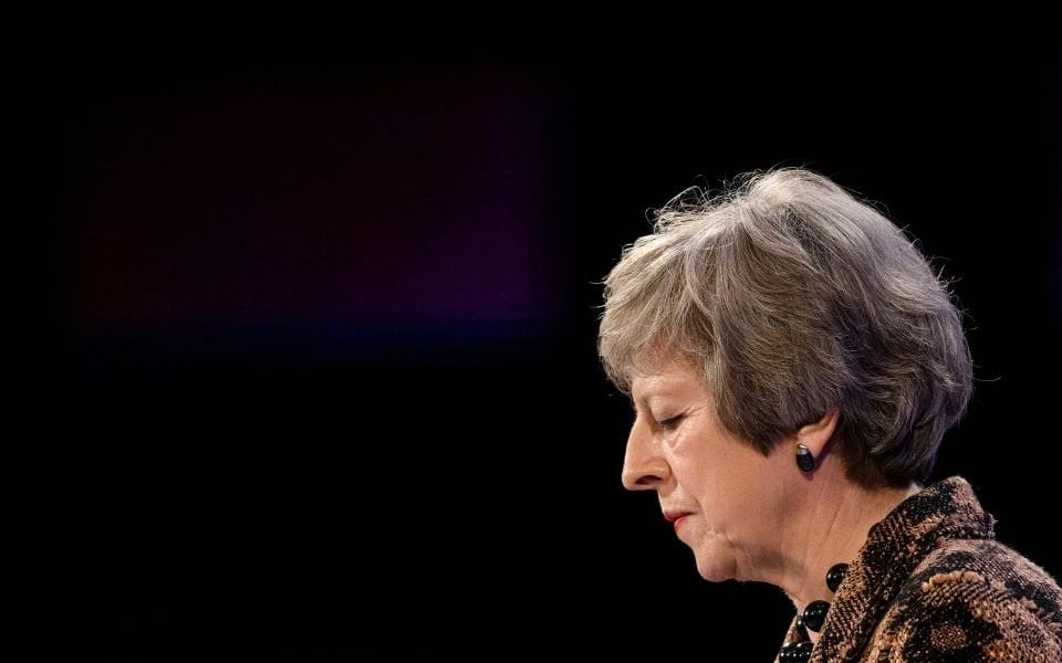 Sterling falls as Theresa May clings to power despite cabinet mutiny over Brexit deal