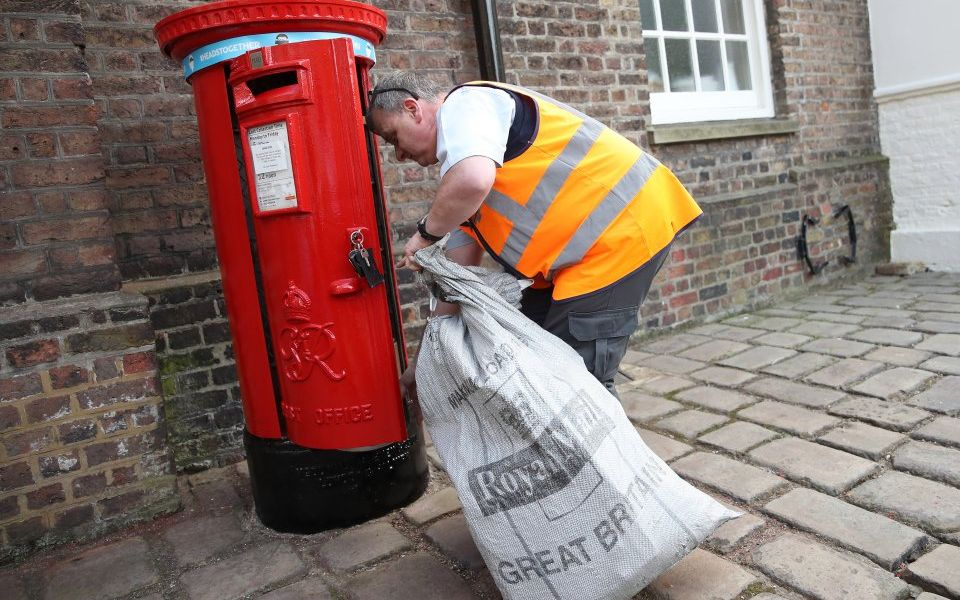 Royal Mail to slash dividend 40 per cent as profit drops by a third