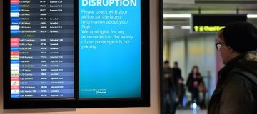 """An information board displays flight information follwing disruption, in the South Terminal building at London Gatwick Airport, south of London, on December 21, 2018, as flights started to resume following the closing of the airfield due to a drones flying. - British police were Friday considering shooting down the drone that has grounded flights and caused chaos at London's Gatwick Airport, with passengers set to face a third day of disruption. Police said it was a """"tactical option"""" after more than 50 sightings of the device near the airfield since Wednesday night when the runway was first closed. (Photo by Ben STANSALL / AFP) (Photo credit should read BEN STANSALL/AFP/Getty Images)"""