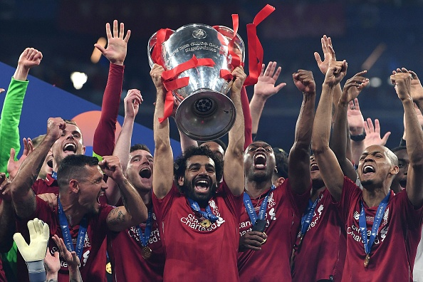 TOPSHOT - Liverpool's Egyptian forward Mohamed Salah (C) raises the European Champion Clubs' Cup as he celebrates with teammates winning the UEFA Champions League final football match between Liverpool and Tottenham Hotspur at the Wanda Metropolitano Stadium in Madrid on June 1, 2019. (Photo by Paul ELLIS / AFP)        (Photo credit should read PAUL ELLIS/AFP/Getty Images)