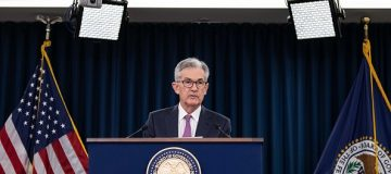 US stock markets hit record highs as Fed chair hints at rate cuts