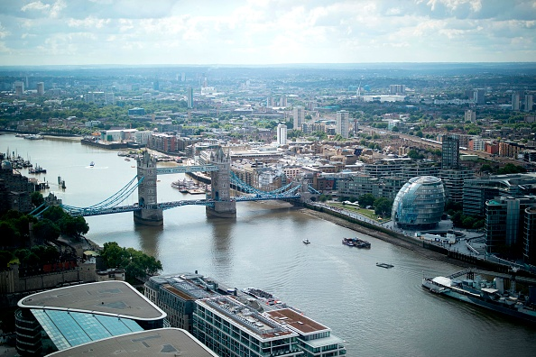 Tower Bridge and the City Hall are pictured on the River Thames, from inside the Sky Garden in London on July 3, 2019. (Photo by Tolga Akmen / AFP) (Photo credit should read TOLGA AKMEN/AFP/Getty Images)